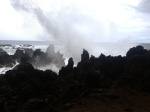 Crashing waves on volcanic rock