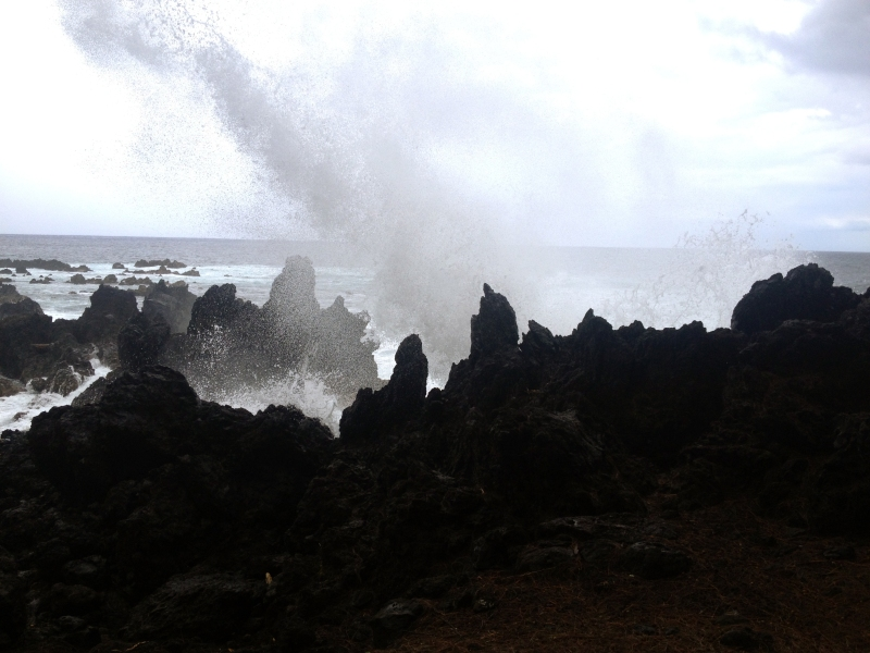 Crashing waves on volcanic rock